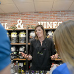 Justin Sheely | The Sheridan Press Brie Thompson, founder of Olivelle of Bozeman, Montana, offers samples of vinegar and olive oil to guests during the grand opening Friday at Verdello on Gr ...