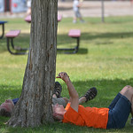 Justin Sheely | The Sheridan Press Debora White and Wade White, visiting from Oregon, find a shady spot Tuesday afternoon in Kendrick Park. Sheridan reached high temperature of 104 Tuesday a ...