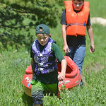 Justin Sheely | The Sheridan Press Monte Walter, front, and Cole Kukuchka carry their kayak back to the parking lot during Tongue River Elementary's Outdoor Education Camp Tuesday at Sible ...