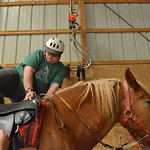 Justin Sheely | The Sheridan Press CHAPS client Dustin Sorenson climbs on a horse with help from instructor Christina Prescatore, left, and intern LexiRainey during the CHAPS Spring Horse Sh ...