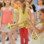 "Justin Sheely | The Sheridan Press Elizabeth Zeilstra picks up the trumpet during a run through for the play ""Aristrocats"" during the YMCA Theater Camp Wednesday. The children have only  ..."