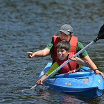 Justin Sheely | The Sheridan Press Camp teacher Meghan Orchard directs third-grader Carmelo Bordeaux as he paddles the kayak during Tongue River Elementary's Outdoor Education Camp Tuesday ...