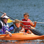Justin Sheely | The Sheridan Press Intern Coren Lamere, left, and fifth-grader Ben Bolter are bumped by Alex Rodriguez in their kayaks during Tongue River Elementary's Outdoor Education Ca ...