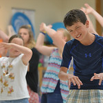 "Justin Sheely | The Sheridan Press Aiden Roth makes an exaggerated expression during a run through for the play ""Aristrocats"" during the YMCA Theater Camp Wednesday. The children have on ..."