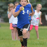 Justin Sheely | The Sheridan Press Ten-year-old Colton Terry runs to a marker for a team relay during Sheridan Olympics Kids Camp Tuesday at Marshall Park. The olympics-themed event was held ...