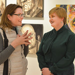 "Justin Sheely | The Sheridan Press Kati Sherwood, left, visits with her former college art classmate Jenna Jordan during the artist reception for ""Modern Masters"" art show Thursday eveni ..."