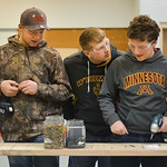 Justin Sheely | The Sheridan Press Tongue River High School students, from left, Kyler Heiling, Cory Loback and Gabe Veilleux drill screws into a board during the Industrial Technology Progr ...
