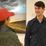 "Justin Sheely | The Sheridan Press Local artist Micah Trampe visits with a guest during the artist reception for ""Modern Masters"" art show Thursday evening at SAGE Community Arts on Brun ..."