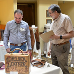 Justin Sheely | The Sheridan Press Show judges Barry King of Sheridan, left, and Jim Linnell of Venus, Texas, look over entries of the competition during the annual Rocky Mountain Leather Cr ...