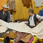 Justin Sheely | The Sheridan Press Kyle and Cindy Butts of Gillette, Wyoming, look at sheep skin during the annual Rocky Mountain Leather Crafters Trade Show Friday at the Sheridan Inn Conve ...