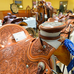 Justin Sheely | The Sheridan Press Leather tooled saddles are seen in the show competition during the annual Rocky Mountain Leather Crafters Trade Show Friday at the Sheridan Inn Convention  ...