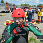 Justin Sheely | The Sheridan Press Goose Valley volunteer firefighter Ben Weaver puts on a helmet and wetsuit during a swift water rescue training exercise Saturday on the Goose Creek by Tho ...