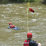 Justin Sheely | The Sheridan Press A first responder throws a rope to a Goose Valley volunteer firefighter during a swift water rescue training exercise Saturday on the Goose Creek by Thorne ...