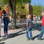 Justin Sheely | The Sheridan Press High school volunteers, left, Kaleigh Padgett and Isabelle Cruz signal Micah Pettyjohn, 8, and Jude Pettyjohn, 6, for a pedestrian safety exercise during t ...