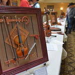 Justin Sheely | The Sheridan Press Leather art is displayed in the showroom during the Rocky Mountain Leather Crafters Trade show Saturday at the Holiday Inn Convention Center.