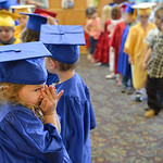 Justin Sheely | The Sheridan Press Laila Crivello waits with her peers in the lobby during The Children's Center Preschool twelfth-annual graduation Thursday night at Sheridan Wesleyan Chu ...