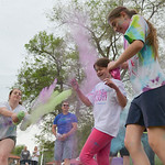 Justin Sheely | The Sheridan Press Eight-year-old Michaela Miller, left, and Gabrielle Miller, 13, get a dossing of color during the Sash Dash color run Saturday at Kendrick Park. The event  ...