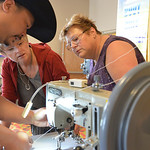 Justin Sheely | The Sheridan Press Brenda Pietsch, left, and Ula Widdel of North Dakota watch as Artisan Sewing Supply associate Chester Wong shows the functions of a leather sewing machine  ...