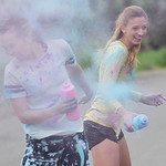 Justin Sheely | The Sheridan Press Miss Outstanding Teen 2015 Olivia Boley, left, and Miss Wyoming 2015 Mikaela Shaw throw color powder at each other during the Sash Dash color run Saturday  ...