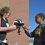Justin Sheely | The Sheridan Press Janet Tuohey, with Sheridan Memorial Hospital, pulls out a helmet for Matthew Osborne during the Safe Kids Bike Rodeo Wednesday at Coffeen Elementary Schoo ...