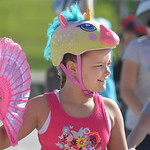 Justin Sheely | The Sheridan Press Fourth-grader Greeli Peterson fans herself as she waits on her bike during the Safe Kids Bike Rodeo Wednesday at Coffeen Elementary School. Sheridan Memori ...