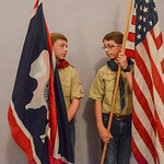 Justin Sheely | The Sheridan Press Boy Scouts Quinton Mangus, left, and Michael Andersen stand by with the state and national flag prior to the Sheridan County Youth and Children's Chorale ...
