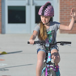 Justin Sheely | The Sheridan Press Fourth-grader Makhia Weiss signals with her right hand before making a turn during the Safe Kids Bike Rodeo Wednesday at Coffeen Elementary School. Sherida ...