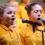Justin Sheely | The Sheridan Press Children's Chorale members Tate Bateman, left, and Gingi Gonzalez sing during the Sheridan County Youth and Children's Chorale Tuesday at the WYO Theat ...