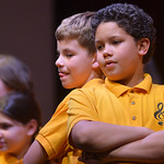 Justin Sheely | The Sheridan Press Youth Chorale members Drake Fisgus, left, and Bryce Allen sing during the Sheridan County Youth and Children's Chorale Tuesday at the WYO Theater. This y ...