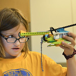 Justin Sheely | The Sheridan Press Third-grader Adrianna Bly holds up a Lego helicopter during an after school Lego Robotics class at Sagebrush Elementary School. The robotics class teaches  ...