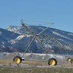 Justin Sheely | The Sheridan Press Irrigation equipment stands in front of the Bighorn Mountains by Beckton Road Wednesday morning. Highway 14 is visible along with locally prominent Steambo ...
