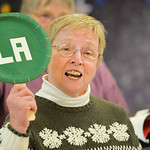 "Justin Sheely | The Sheridan Press Sheridan Aires Choir member Jacky Jones holds up a sign as the members sing ""Deck the Halls"" during practice Tuesday for the Magic of Christmas show at ..."