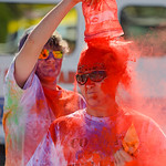 Justin Sheely | The Sheridan Press Yvonne Swanson freezes as Gunnar Swanson dumps colored powder over her head during the 5th annual Combat Color Run Saturday at Sheridan College. The event  ...