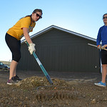Justin Sheely | The Sheridan Press School teachers Janelle Dill, left, and Jamie Fortman rake up rocks in preparation for laying sod at the Baker's Habitat for Humanity home on Saturday. T ...