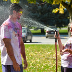 Justin Sheely | The Sheridan Press Ian Scofield receives more than he bargained for as Alison Wigglesworth rinses off powder color during the 5th annual Combat Color Run Saturday at Sheridan ...