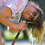 Justin Sheely | The Sheridan Press Carsen Mowry rinses her hair during the 5th annual Combat Color Run Saturday at Sheridan College. The event was hosted by and benefits the Student Veterans ...