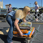 Justin Sheely | The Sheridan Press Kayla Wilbanks puts bags of dog food on the wagon during the fourth-annual Dog Weight Pull contest Saturday at Muddy Paw Prints Pet Supply.