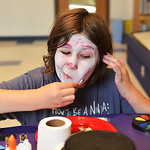 Justin Sheely | The Sheridan Press Ten-year-old Valerie Kurtz puts makeup on her face during the Tween Zombie Fest Tuesday at the Sheridan County Fulmer Public Library. The event focused on  ...