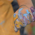 Justin Sheely | The Sheridan Press A Sheridan Junior High School student squeezes paint inside her fist during an abstract workshop Thursday in the Whitney Center for the Arts building at Sh ...