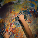 Justin Sheely | The Sheridan Press A Sheridan Junior High School student reaches paints the canvas with her hands during an abstract workshop Thursday in the Whitney Center for the Arts buil ...