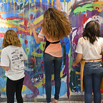Justin Sheely | The Sheridan Press Sheridan Junior High School students reach as high on the canvas as possible during an abstract workshop Thursday in the Whitney Center for the Arts buildi ...