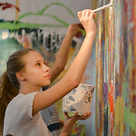 Justin Sheely | The Sheridan Press Sheridan Junior High School student Audrey Turner applies paint to her team's canvas during an abstract workshop Thursday in the Whitney Center for the A ...