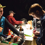 Justin Sheely | The Sheridan Press Twelve-year-old Aiden Vielhauer and Ben Novotny sign in before working in the Boy Scouts' annual Haunted House Tuesday night at the old Sheridan Iron Wor ...