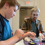 Justin Sheely | The Sheridan Press Eleven-year-old Ethan McGill makes bite marks on his arm during the Tween Zombie Fest Tuesday at the Sheridan County Fulmer Public Library. The event focus ...