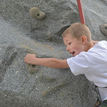 Justin Sheely | The Sheridan Press Five-year-old Ben Meyer looks out as he climbs a rock wall for Big Horn Fun Friday at the YMCA parking lot. The YMCA provides activities for Big Horn stude ...