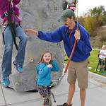 Justin Sheely | The Sheridan Press YMCA Youth Program Director Cameron Groteluschen deflects a girl repelling as Maddie Thompson, 8, reacts during rock climbing for Big Horn Fun Friday at th ...