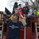 Justin Sheely | The Sheridan Press Firefighter Larry Grooms helps Riley Costa, 6, off of the 1944 American LaFrance fire truck during the Fire Prevention Week Open House Saturday at Sheridan ...