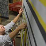 "Justin Sheely | The Sheridan Press Artist Pat Trout puts up tape to mark and edge as she paints the stage sets for the upcoming Wyo Theater Gala: ""Lend Me a Tenor"" Thursday at a private  ..."
