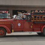 Justin Sheely | The Sheridan Press Guests ride on a 1944 American LaFrance fire truck during the Fire Prevention Week Open House Saturday at Sheridan Fire-Rescue.