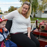 Justin Sheely | The Sheridan Press Two-year-old Charlie Stevens sits with Pepper Stevens as they ride the 1944 American LaFrance fire truck during the Fire Prevention Week Open House Saturda ...